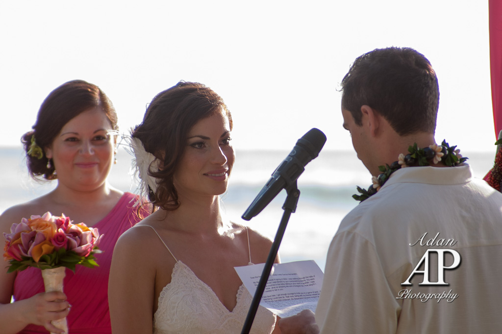 This is a photograph of a bride and groom getting married in Honolulu Hawaii.